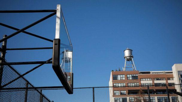 PHOTO: A basketball backboard stands without hoop, after it was removed to prevent people from spreading coronavirus by gathering in Brooklyn, New York, March 27, 2020. (Michael Nagle/Xinhua via Getty Images)