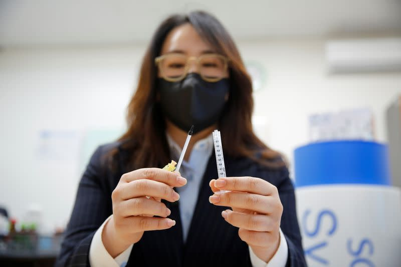 Cho Mi-heui, vice president of PoongLim Pharmatech Inc. showcases a sample of a low dead space (LDS) syringe at a company office in Gunsan