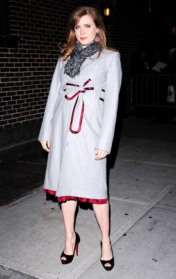 "On the other (and chillier) side of the country, a pregnant Amy Adams glowed upon arriving for a taping of ""Late Show With David Letterman"" in a super stylish coat, Louis Vuitton scarf, and pretty peep-toes. Ray Tamarra/<a href=""http://www.gettyimages.com/"" target=""new"">GettyImages.com</a> - January 5, 2010"