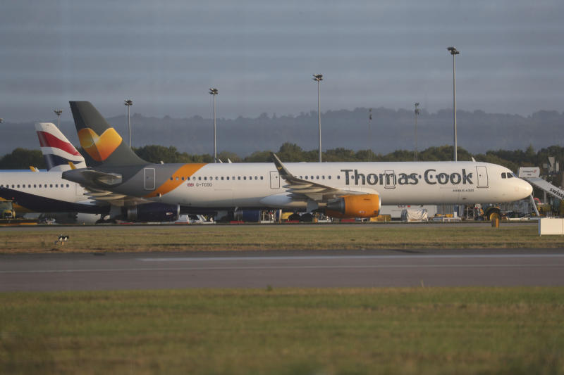 A Thomas Cook plane on the tarmac at Gatwick Airport in Sussex, England Monday Sept. 23, 2019. British tour company Thomas Cook collapsed early Monday after failing to secure emergency funding, leaving tens of thousands of vacationers stranded abroad. (Steve Parsons/PA via AP)