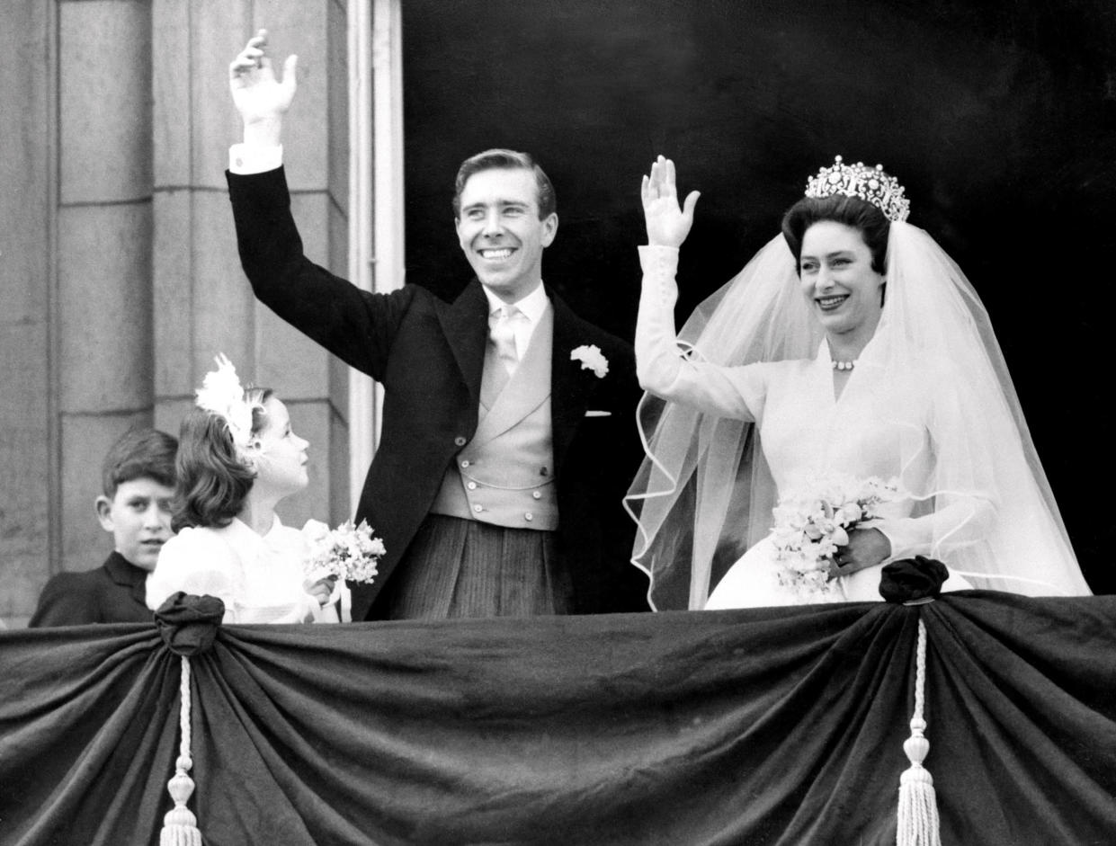 The newly-wed Princess Margaret and her husband, Antony Armstrong-Jones wave from Buckingham Palace on their wedding day in 1960 (Getty)