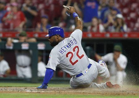 May 19, 2018; Cincinnati, OH, USA; Chicago Cubs right fielder Jason Heyward slides safely into home after a double hit by center fielder Albert Almora Jr. against the Cincinnati Reds during the ninth inning at Great American Ball Park. Mandatory Credit: David Kohl-USA TODAY Sports