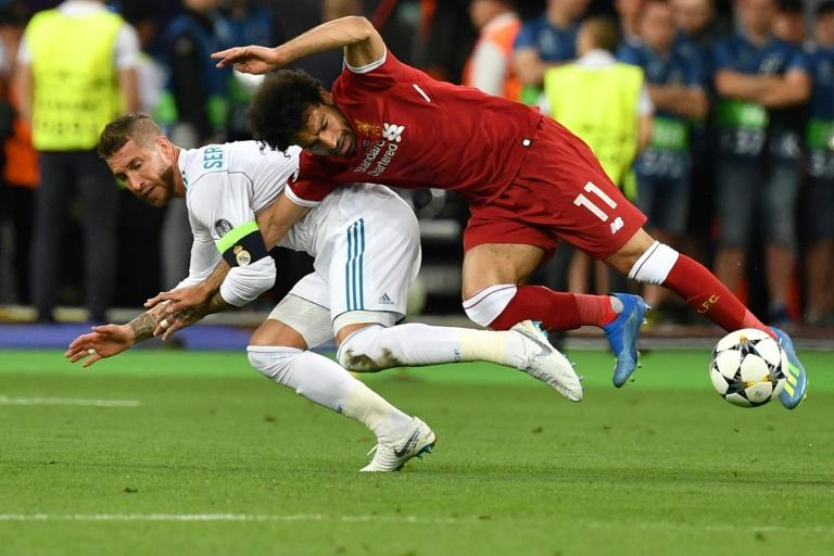 Mohamed Salah injured his shoulder in this challenge by Real Madrid's Sergio Ramos