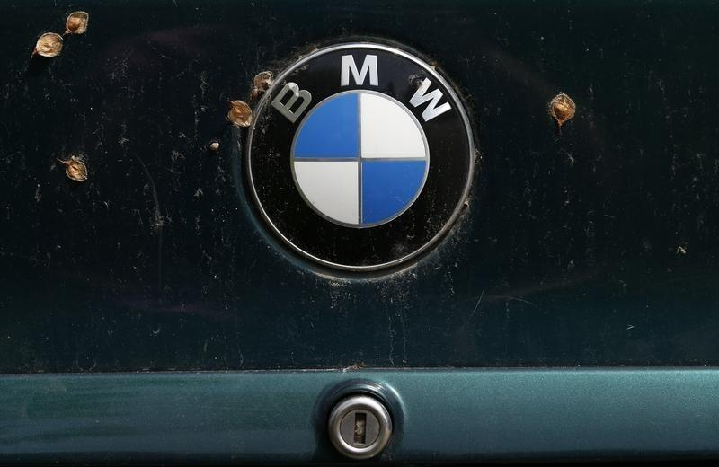 A BMW logo is pictured on a car's back at a scrapyard in Fuerstenfeldbruck