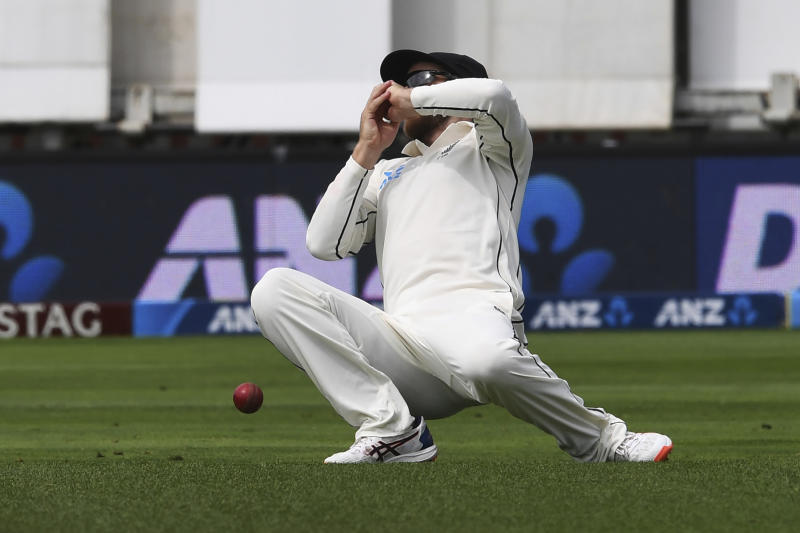 New Zealand's Kane Williamson drops a catch off the batting of India's Ishant Sharma during the first cricket test between India and New Zealand at the Basin Reserve in Wellington, New Zealand, Saturday, Feb. 22, 2020. (AP Photo/Ross Setford)