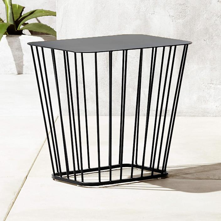 """I like the idea of letting some ferns or vines interact with this metal table—growing in and out of the wire base. $169, CB2. <a href=""""https://www.cb2.com/black-wire-side-table/s143886"""" rel=""""nofollow noopener"""" target=""""_blank"""" data-ylk=""""slk:Get it now!"""" class=""""link rapid-noclick-resp"""">Get it now!</a>"""