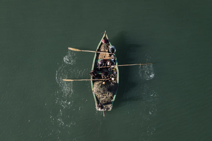 Fishermen return to shore near the La Saline neighborhood of Port-au-Prince, Haiti, Monday, July 19, 2021. The country of more than 11 million people is still reeling from the July 7 killing of President Jovenel Moise. (AP Photo/Matias Delacroix)