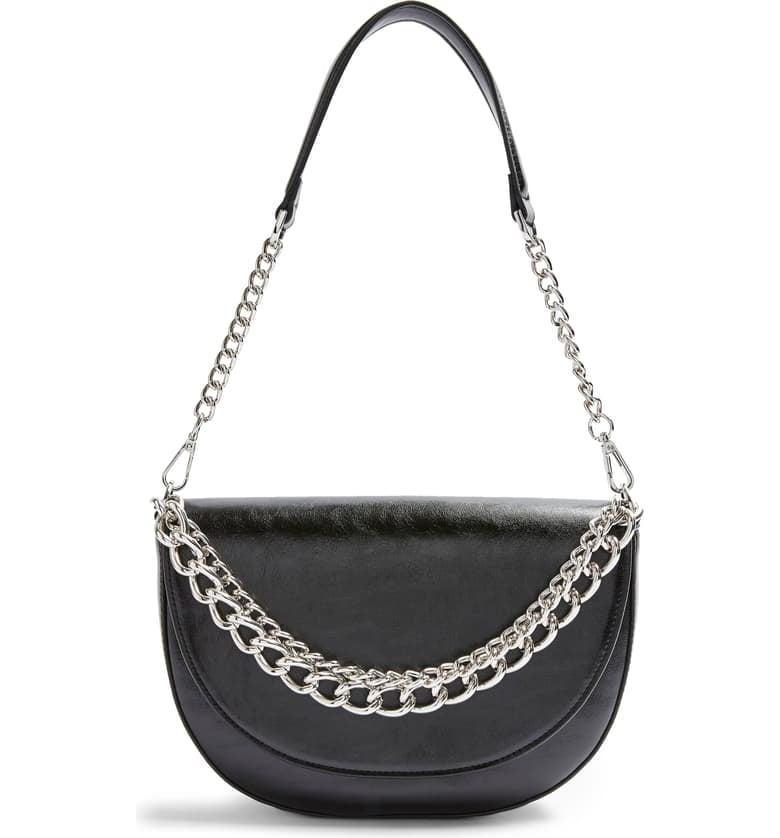 "<p>This <a href=""https://www.popsugar.com/buy/Topshop-Spill-Chain-Shoulder-Bag-494350?p_name=Topshop%20Spill%20Chain%20Shoulder%20Bag&retailer=shop.nordstrom.com&pid=494350&price=52&evar1=fab%3Aus&evar9=46680531&evar98=https%3A%2F%2Fwww.popsugar.com%2Ffashion%2Fphoto-gallery%2F46680531%2Fimage%2F46680534%2FTopshop-Spill-Chain-Shoulder-Bag&list1=shopping%2Cnordstrom%2Cgift%20guide%2Cgifts%20for%20her&prop13=mobile&pdata=1"" rel=""nofollow"" data-shoppable-link=""1"" target=""_blank"" class=""ga-track"" data-ga-category=""Related"" data-ga-label=""https://shop.nordstrom.com/s/topshop-spill-chain-shoulder-bag/5440251?origin=category-personalizedsort&amp;breadcrumb=Home%2FWomen%2FNew%20Arrivals&amp;color=black"" data-ga-action=""In-Line Links"">Topshop Spill Chain Shoulder Bag</a> ($52) walks the line perfectly between classic and on trend.</p>"