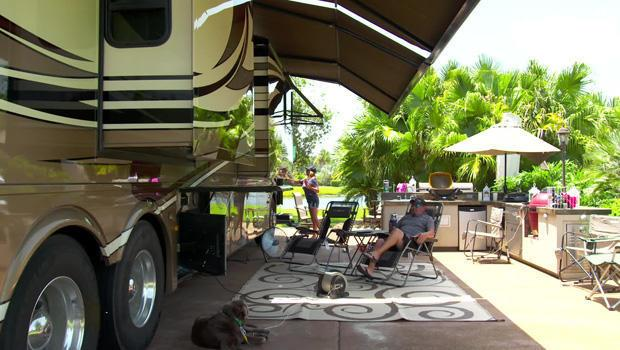 Home sweet home: Mike Marlowe relaxes outside his RV. / Credit: CBS News