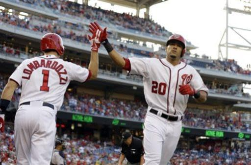 Washington Nationals' Ian Desmond (20) celebrates his solo home run with Stephen Lombardozzi (1) during the second inning of a baseball game against the Colorado Rockies at Nationals Park, Thursday, June 20, 2013, in Washington. (AP Photo/Alex Brandon)