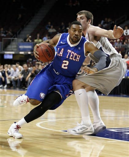 Louisiana Tech guard Brandon Gibson (2) drives by Nevada forward Olek Czyz (31) during their NCAA college basketball game in the Western Athletic Conference tournament Friday, March 9, 2012, at The Orleans Arena in Las Vegas