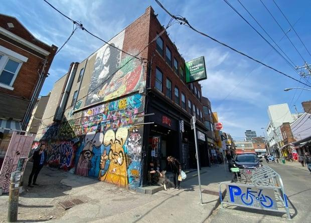 City council voted Thursday to approve a motion to give The Kensington Market Community Land Trust, a non-profit organization, $3 million to acquire, renovate and operate a building at 54-56 Kensington Ave. as affordable housing for the next 99 years. (Martin Trainor/CBC - image credit)