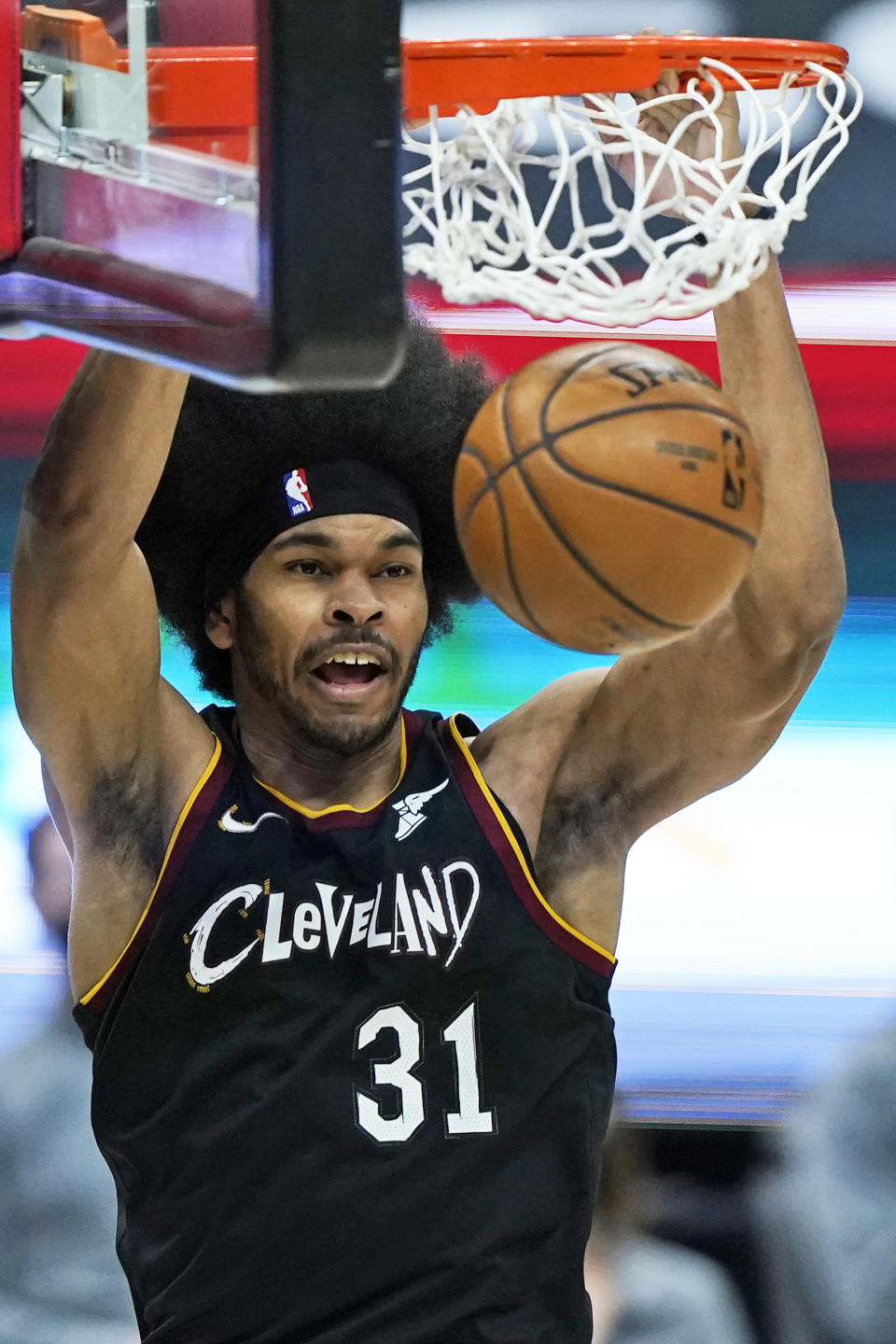 Cleveland Cavaliers' Jarrett Allen dunks against the Chicago Bulls during the second half of an NBA basketball game, Wednesday, April 21, 2021, in Cleveland. (AP Photo/Tony Dejak)