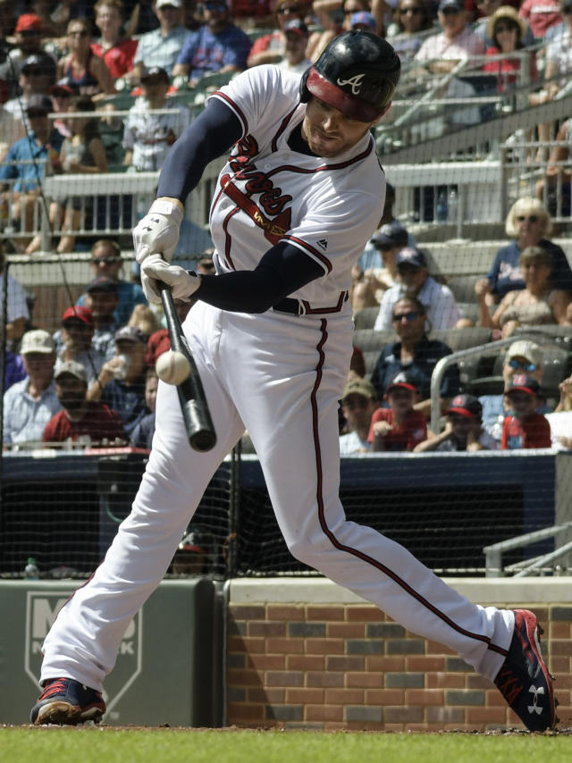 Atlanta Braves' Freddie Freeman connects for a sacrifice fly to centerfield during the first inning of a baseball game against the Washington Nationals, Saturday, Sept. 15, 2018, in Atlanta. Ronald Acuna Jr. scored on the play. (AP Photo/John Amis)