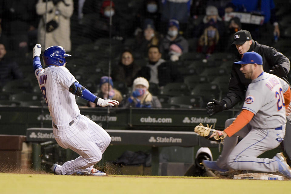 Chicago Cubs Ian Happ (8) is tagged out by New York Mets first baseman Pete Alonso (20) after scrambling back to first during the fourth inning of a baseball game Wednesday, April 21, 2021, in Chicago. (AP Photo/Mark Black)