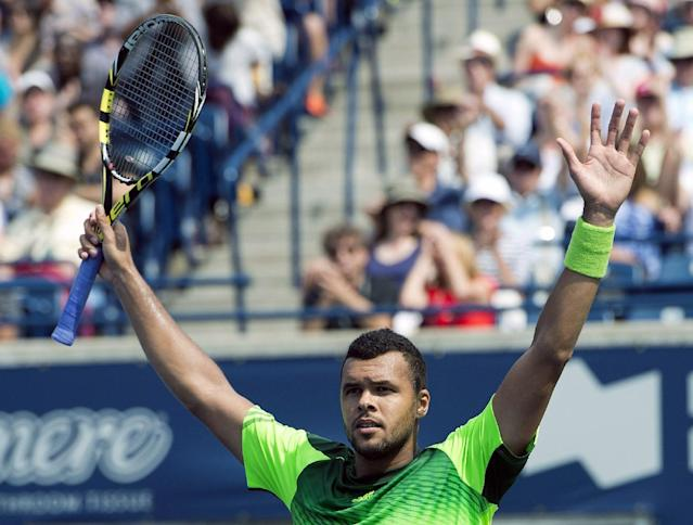Jo-Wilfried Tsonga of France celebrates his win over Andy Murray of Great Britain at the Rogers Cup tennis tournament, Friday, Aug. 8, 2014 in Toronto. (AP Photo/The Canadian Press, Frank Gunn)