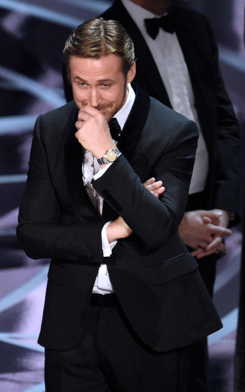 La La Land star Ryan Gosling reacts as the true winner is revealed - Credit: Chris Pizzello/Invision/AP
