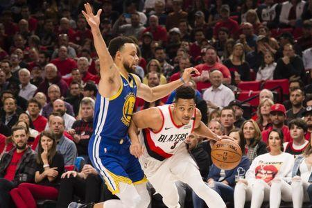 May 20, 2019; Portland, OR, USA; Portland Trail Blazers guard CJ McCollum (3) drives to the basket against Golden State Warriors guard Stephen Curry (30) during the first half in game four of the Western conference finals of the 2019 NBA Playoffs at Moda Center. Mandatory Credit: Troy Wayrynen-USA TODAY Sports