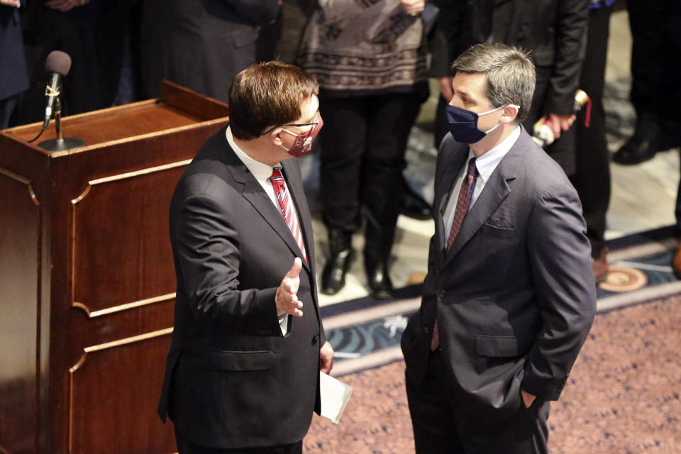 South Carolina House Speaker Jay Lucas, left, and Senate Majority Leader Shane Massey, right, talk before a news conference to celebrate the likelihood of a bill banning almost all abortions passing getting to his desk after a news conference on Wednesday, Jan. 27, 2021, in Columbia, S.C. The Senate passed the bill on an initial vote. (AP Photo/Jeffrey Collins)