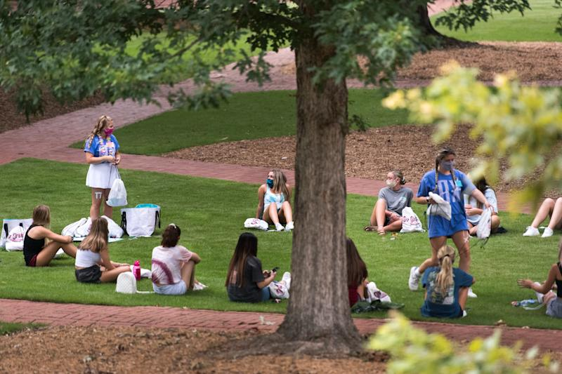 COLUMBIA, SC - AUGUST 10: College students participate in a sorority activity at the University of South Carolina on August 10, 2020 in Columbia, South Carolina. Students began moving back to campus housing August 9 with classes to start August 20. (Photo by Sean Rayford/Getty Images)