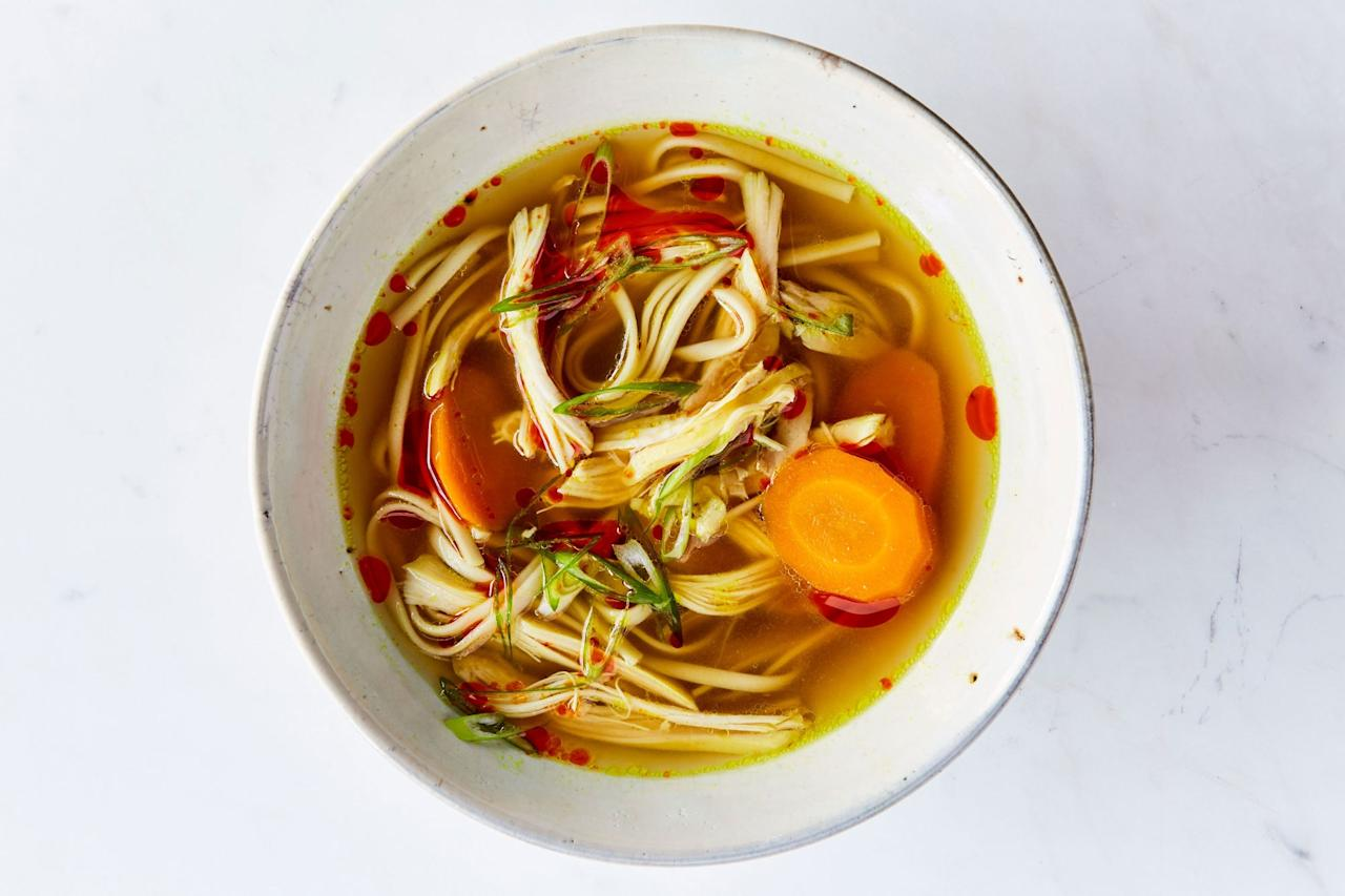 """Chicken noodle soup never gets old. If you don't have udon for this recipe, use rice noodles or regular old spaghetti. A small knob of fresh turmeric can replace the dried type. <a href=""""https://www.epicurious.com/recipes/food/views/turmeric-ginger-chicken-soup?mbid=synd_yahoo_rss"""">See recipe.</a>"""
