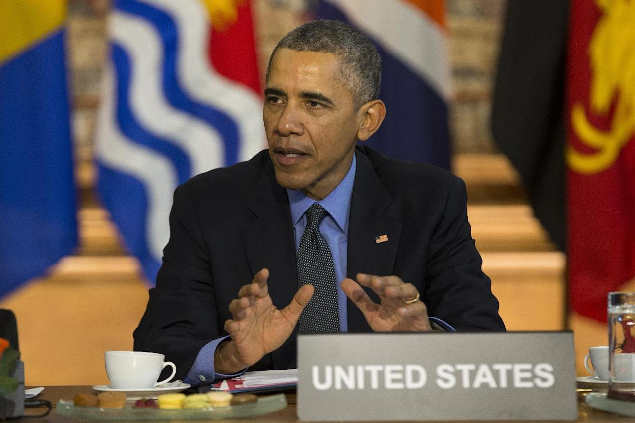 FILE - In this Dec. 1, 2015 file photo, President Barack Obama speaks during a meeting with heads of state from small island nations most at risk from the harmful effects of climate change, in Paris. If the nation doesn't do more, the United States probably won't quite meet the dramatic heat-trapping gas reduction goal it promised in last year's Paris agreement to battle climate change, according to a new study. (AP Photo/Evan Vucci, File)
