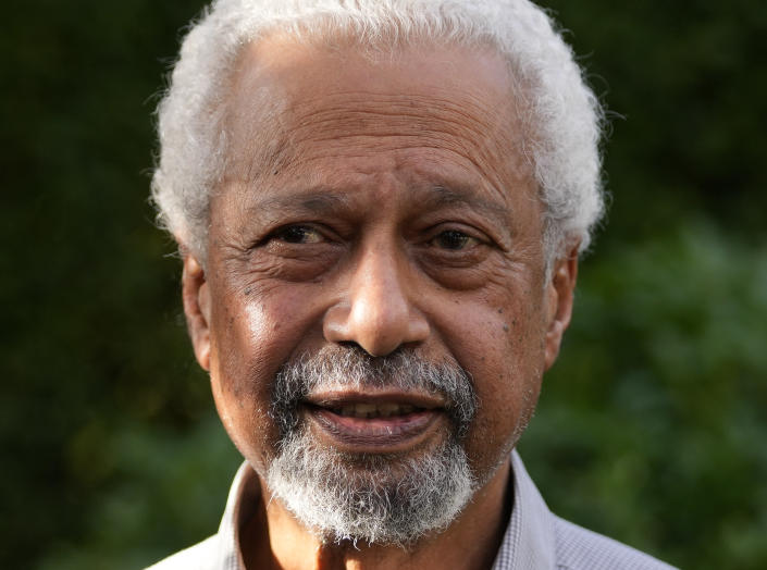 """Tanzanian writer Abdulrazak Gurnah poses for a photo at his home in Canterbury, England, Thursday, Oct. 7, 2021. Gurnah was awarded the Nobel Prize for Literature earlier on Thursday. The Swedish Academy said the award was in recognition of his """"uncompromising and compassionate penetration of the effects of colonialism."""" (AP Photo/Frank Augstein)"""