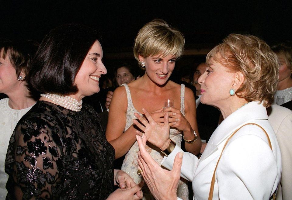 <p>As Barbara Walters chatted up Princess Diana and her friend, Lucia Flecha de Lima, the news broadcaster wore a crisp white blazer and pale blue statement earrings. </p>