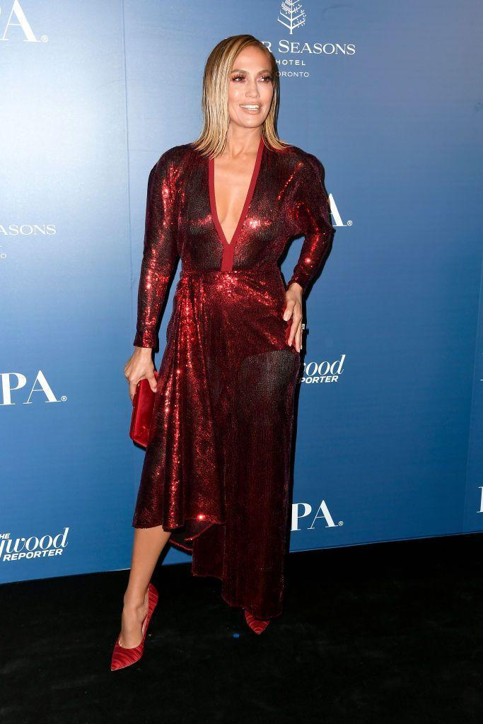 <p>For her second day of TIFF promo, Lopez kept the blonde bob but changed into a red sequin wrap dress by Elie Saab. </p>