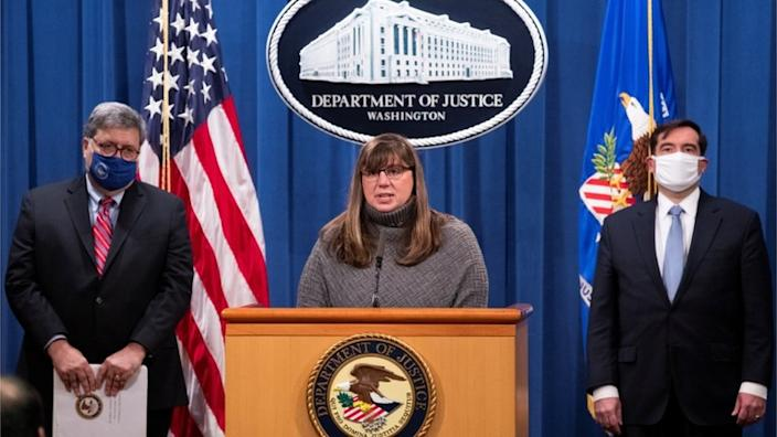 Kara Weipz (C), representative on behalf of the Pan Am 103 victims and their families, delivers remarks beside US Attorney General William Barr (L) and assistant Attorney General for National Security John Demers (R)