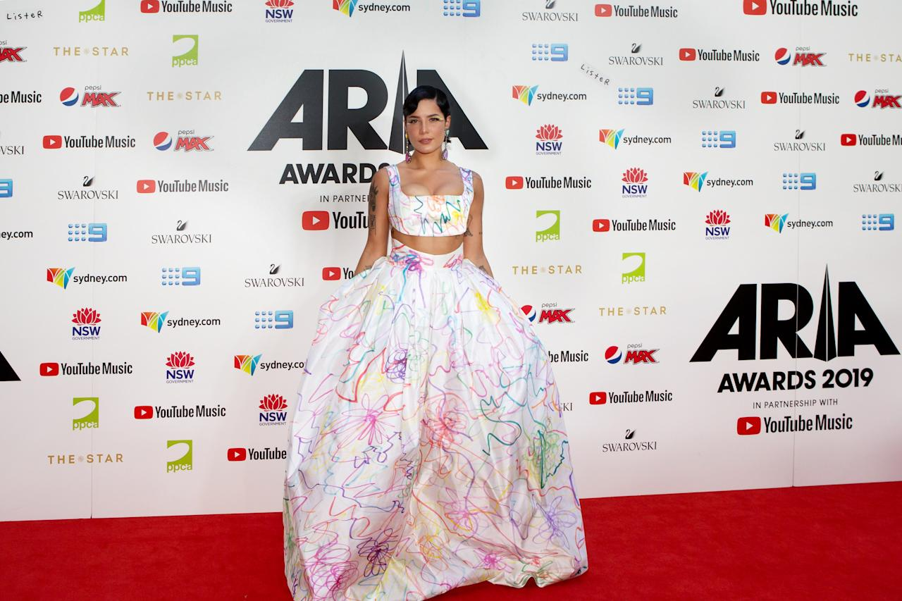The pop star was a walking work of art in this white gown. The dress was covered in bits of colorful detailing, and she continued the trend with her choice of eye makeup.