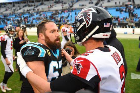 FILE PHOTO: Dec 23, 2018; Charlotte, NC, USA; Carolina Panthers center Ryan Kalil (67) with Atlanta Falcons quarterback Matt Ryan (2) after the game at Bank of America Stadium. Mandatory Credit: Bob Donnan-USA TODAY Sports - 11893141