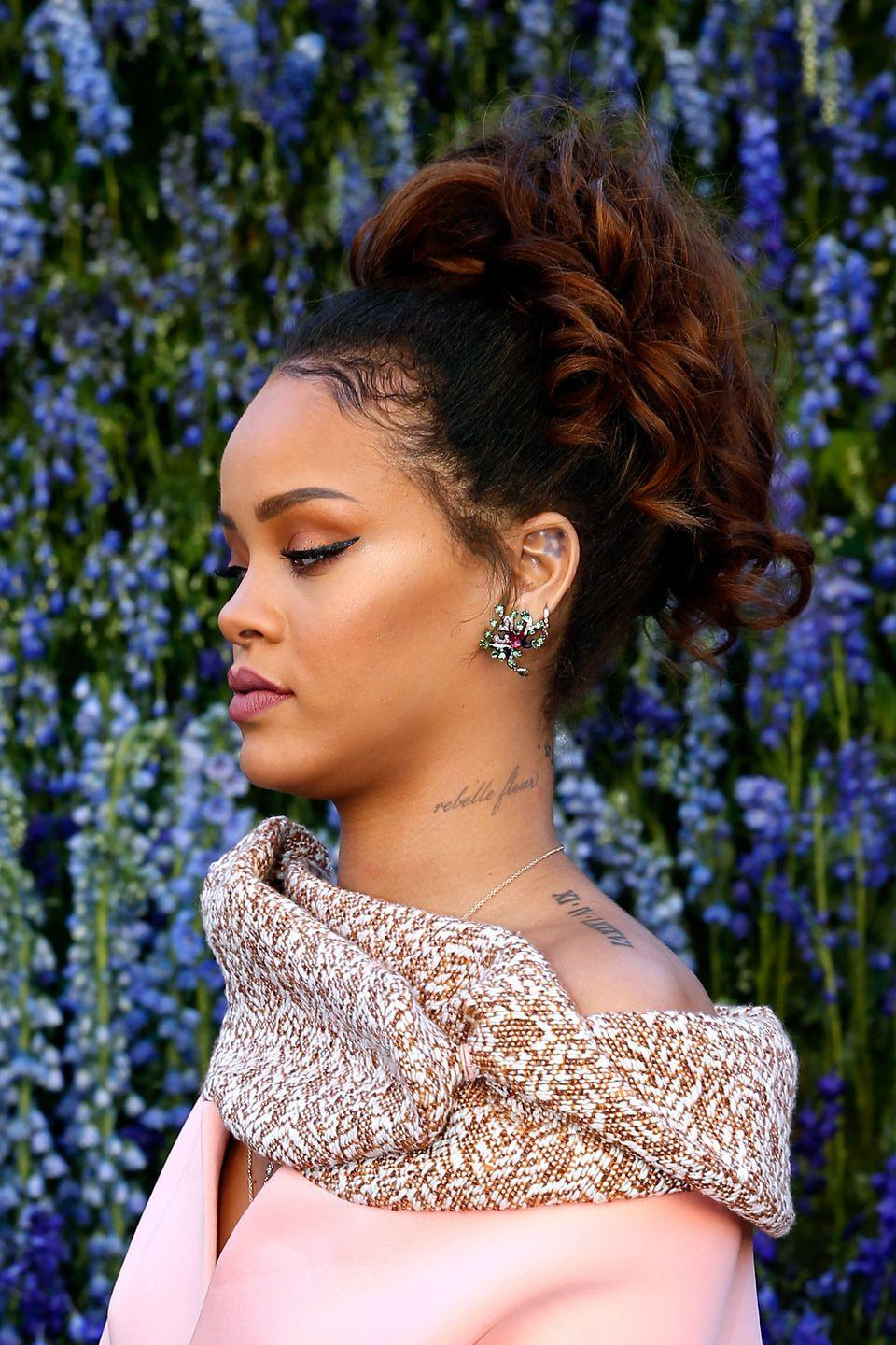 <p>In 2010, Rihanna had the French words 'rebelle fleur' inked permanently on her neck which translates to 'rebel flower'.</p>