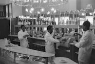 <p>Bartenders at a bar in Lagos, Nigeria. As one of Nigeria's major cities, Lagos is home to an action-packed range of bars, restaurants and clubs.</p>