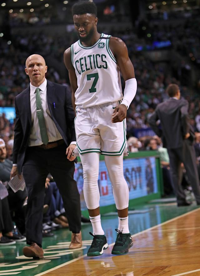 BOSTON, MA - APRIL 28: Boston Celtics Jaylen Brown limps as he heads to the locker room after getting hurt in the second quarter. The Boston Celtics hosted the Milwaukee Bucks for Game Seven of their NBA Eastern Conference first round playoff series at TD Garden in Boston on April 28, 2018. (Photo by Jim Davis/The Boston Globe via Getty Images)