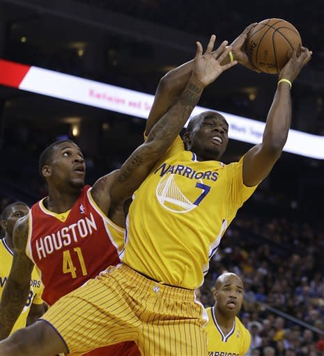 Houston Rockets' Thomas Robinson (41) and Golden State Warriors' Carl Landry (7) fight for a rebound during the first half of an NBA basketball game Friday, March 8, 2013, in Oakland, Calif. (AP Photo/Ben Margot)