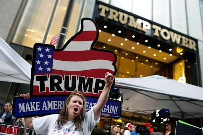 Donald Trump supporters rally outside Trump Tower on Saturday. (Photo: Eduardo Munoz/Reuters)