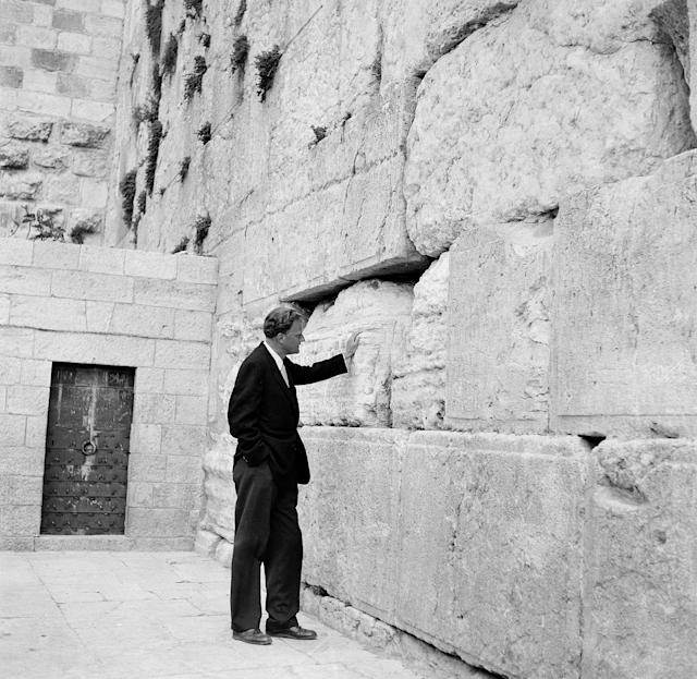 <p>Billy Graham stands by the Wailing Wall in Jerusalem, on March 17, 1960, after an 18,000-mile preaching tour in Africa and the Middle East. (Photo: Leila Wynn/AP) </p>