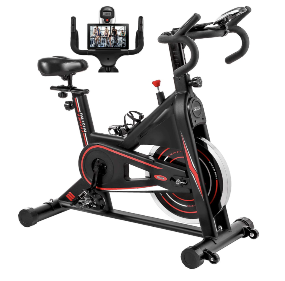 black indoor stationary exercise bike with red details and tablet screen