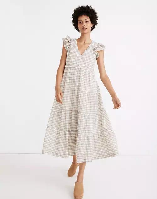 <p>Spring picnics in the park call for this cute <span>Madewell Gingham Seersucker Ruffle-Sleeve Tiered Midi Dress</span> ($148).</p>