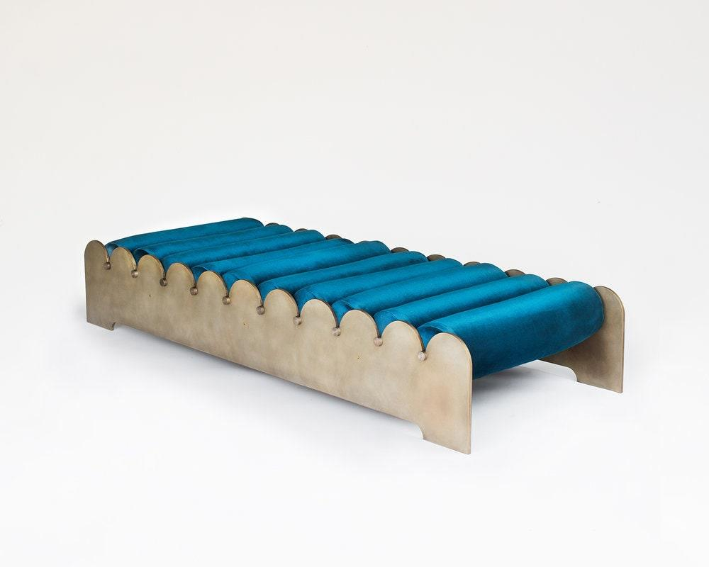 "Los Angeles–based design company Laun is making some seriously good outdoor furniture, and <a href=""https://www.launlosangeles.com/furniture#/bobbin-bench"">this bench</a> in particular stopped us in our tracks. The rich blue cushions and the curvy aluminum evoke the waves of the Pacific. It's out of our price range but it's worthy of daydreams."
