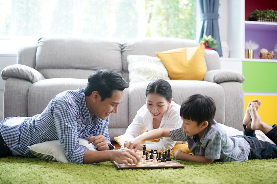 Parents spending time to playing with their kid builds a bond and lets child know he is loved and appreciated helps to develop strong family and emotional in child