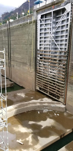 This Sunday, Sept. 8, 2019 photo provided by the U.S. Army Corps of Engineers shows a crack in a concrete sill on a boat lock on the Bonneville Dam on the Columbia River that connects Oregon and Washington at Cascade Locks., Ore. A critical lock has shut down for repairs, meaning barges that shuttle millions of tons of wheat, wood and other inland goods to the Pacific Ocean for transport to Asia can't move. An official said Monday, Sept. 9, 2019 that a crack in the Bonneville Dam lock's concrete sill was discovered late last week. It's not clear when repairs will be complete. (Megan Innes/U.S. Army Corps of Engineers via AP)