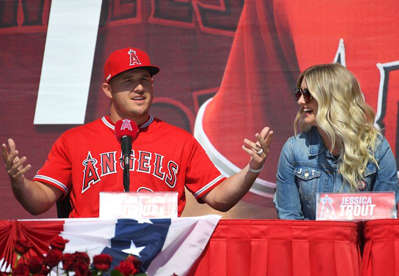 ANAHEIM, CA - MARCH 24: Mike Trout #27 of the Los Angeles Angels of Anaheim, sits with his wife Jessica Trout as he attends a press conference after agreeing to the terms of a 12-year, $430 million contract extension at Angel Stadium of Anaheim on March 24, 2019 in Anaheim, California. (Photo by Jayne Kamin-Oncea/Getty Images)