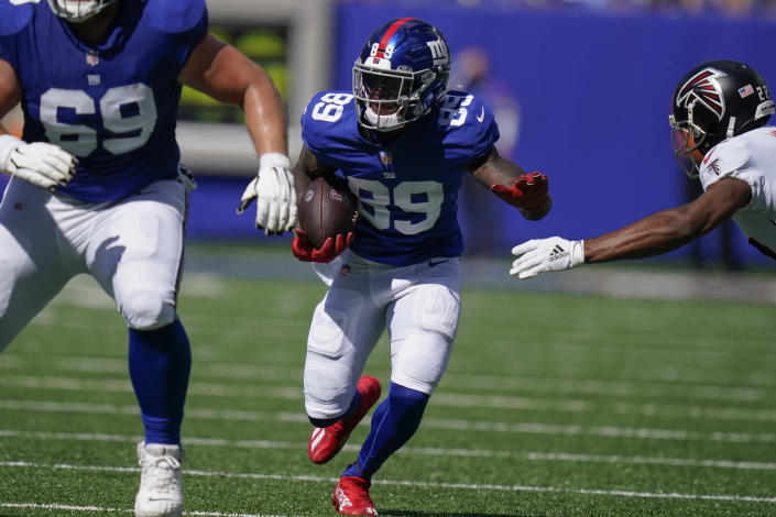 New York Giants wide receiver Kadarius Toney (89) runs the ball against Atlanta Falcons cornerback Fabian Moreau, right, during the first half of an NFL football game, Sunday, Sept. 26, 2021, in East Rutherford, N.J. (AP Photo/Seth Wenig)
