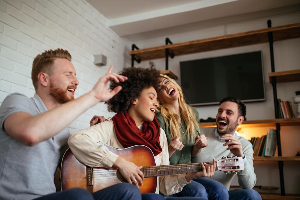 group having a jam sesh together playing guitar