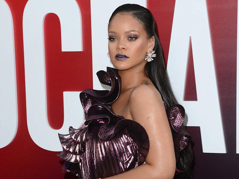 Rihanna trying to find balance in her life after 'overwhelming' year