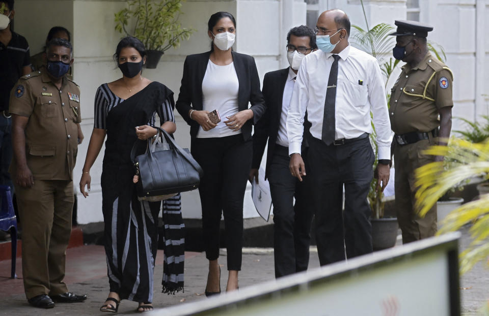 Former Mrs. Sri Lanka 2019 and current Miss World Caroline Jurie (C) leaves Cinnamon Gardens Police Station after being released on bail in Colombo on  April 8, 2021 following her arrest on charges of assault over an on-stage fracas in which she pulled the crown off the head of the new