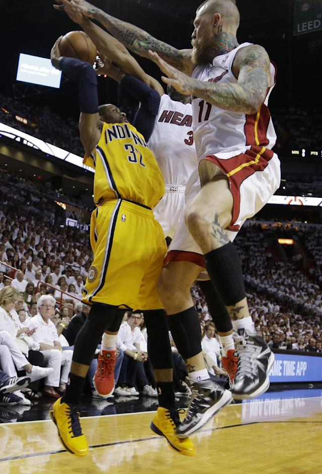 Miami Heat forward Chris Andersen (11) and guard Dwyane Wade (3) defend Indiana Pacers guard C.J. Watson (32) during the first half of Game 3 in the NBA basketball Eastern Conference finals playoff series, Saturday, May 24, 2014, in Miami. Andersen was called for a foul. (AP Photo/Lynne Sladky)