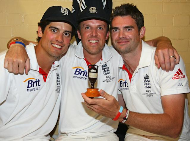 England cricketers Alastair Cook (L), Graeme Swann (C) and James Anderson (R) celebrate in the dressing room with a replica of the Ashes urn, after winning the series 3-1 during day five of the Fifth Ashes Test match between Australia and England, at Sydney Cricket Ground on January 7, 2011 in Sydney, Australia, on January 7, 2011. AFP PHOTO/TOM SHAW/POOL IMAGE STRICTLY RESTRICTED TO EDITORIAL USE - STRICTLY NO COMMERCIAL USE (Photo credit should read TOM SHAW/AFP/Getty Images)